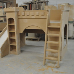An unpainted Leeds castle with a straight slide and a ladder replacing the second bookcase.