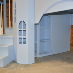 The optional octagonal tower includes shelves inside. The small bookshelf is added in.