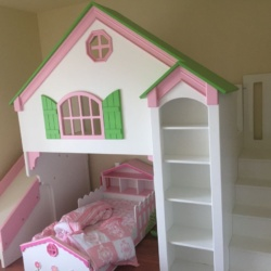 A twin over twin Dollhouse with paneled staircase and slide. Base painted white with pink and green trim.