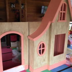 This cottage was sent out prime painted, and painted by the family at their home.
