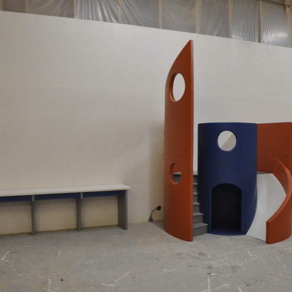 Modern Playhouse with curving slide and curving staircase.