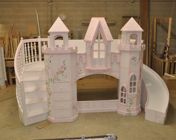 Princess castle bunk bed with curving staircase, curving slide, and hand-painted roses.