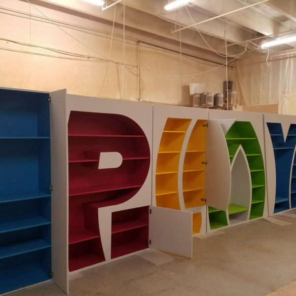 letter shaped bookcase