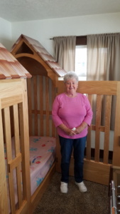Louise with the bed she helped create.