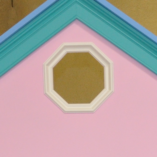 Octagonal window on a dollhouse bunk