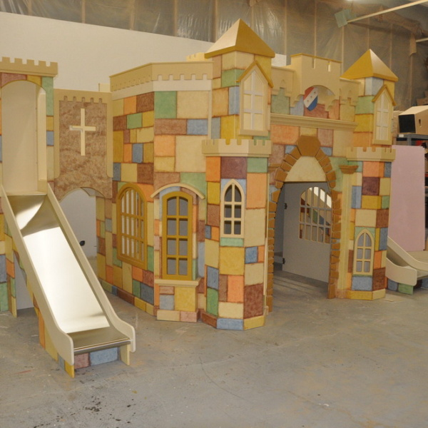 Large Indoor Playhouse with two slides and a staircase.