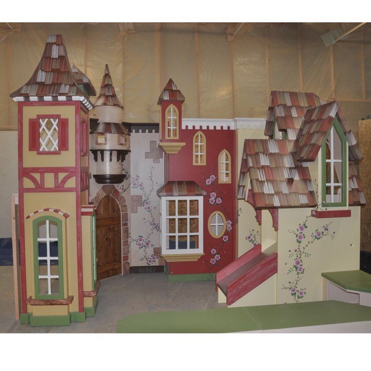 Reilly Dental custom hand painted indoor village playhouse with slide and stairs