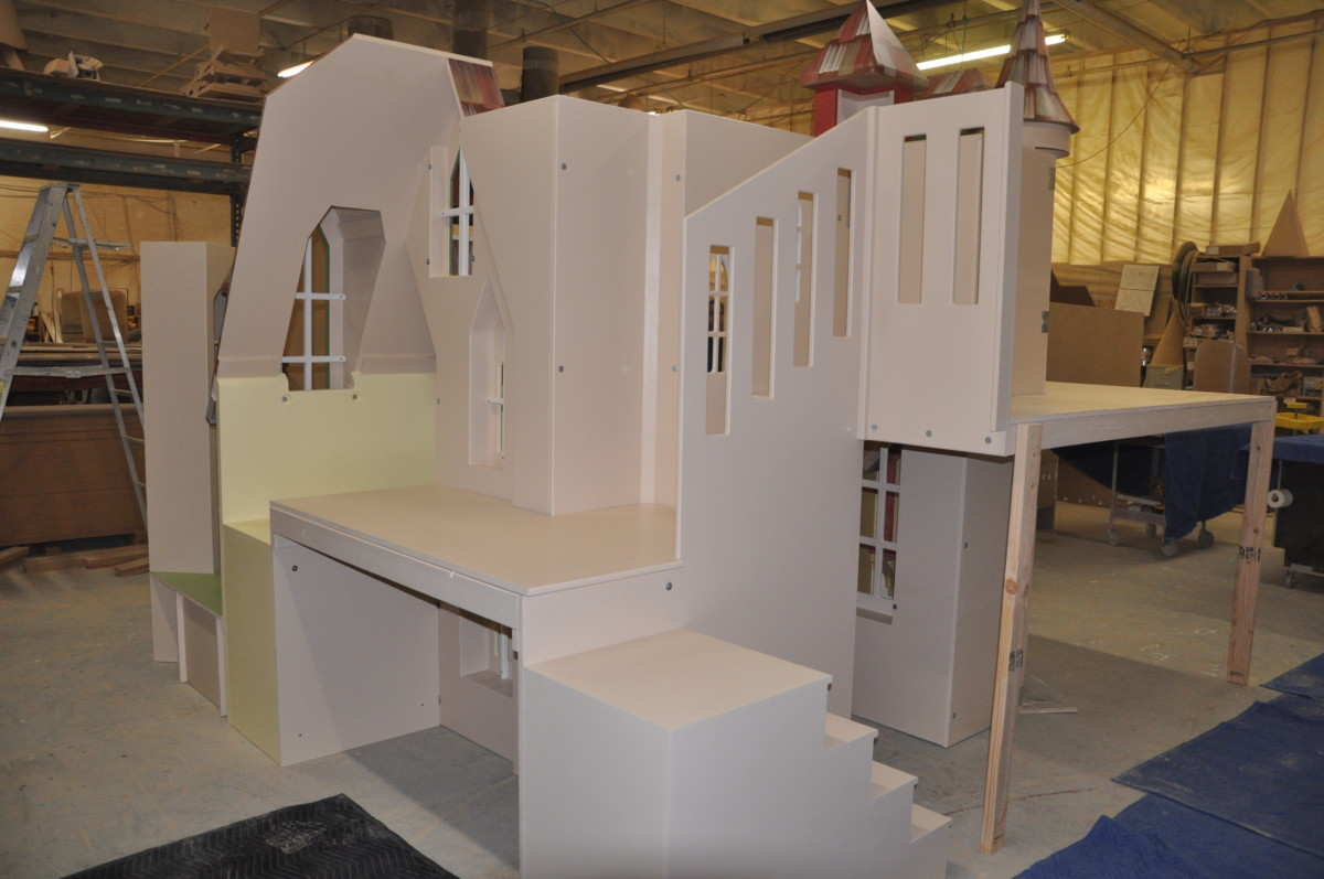 Indoor playhouse for a waiting room with benches and bookshelf.