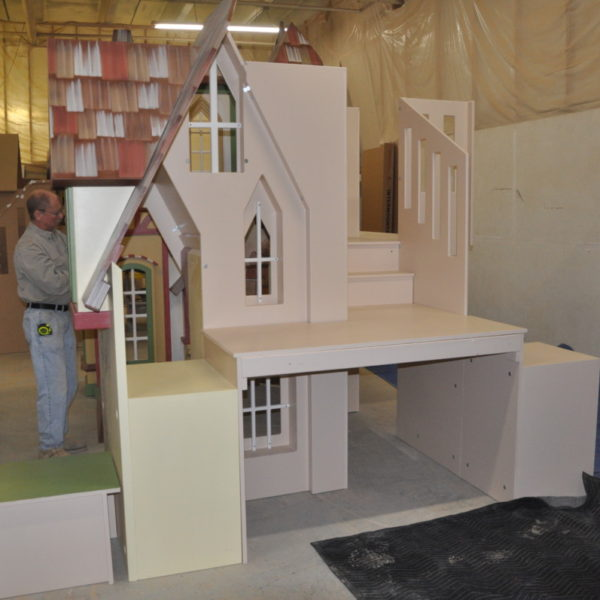 Indoor village playhouse for a waiting room with bookshelf, benches and storage space.