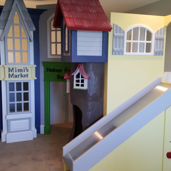 Storefront Playhouse with Treehouse