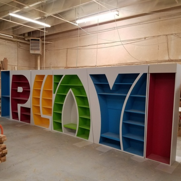 Bookcase shaped like PLAY